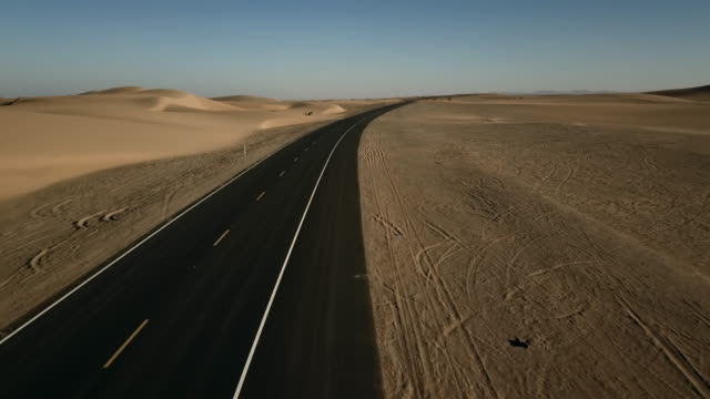 aerial view of empty road in desert and sand dunes - empty road stock videos and b-roll footage
