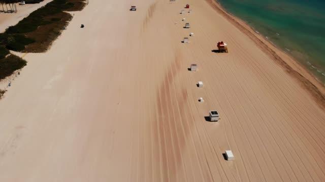 aerial view of empty south beach and deco drive during covid-19 pandemic, miami beach, miami, florida, united states of america, north america - cabina del guardaspiaggia video stock e b–roll