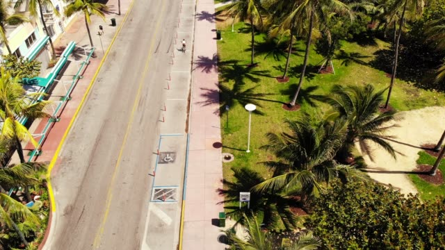 aerial view of empty south beach and deco drive during covid-19 pandemic, miami beach, miami, florida, united states of america, north america - modern art stock videos & royalty-free footage