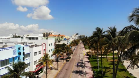 vidéos et rushes de aerial view of empty south beach and deco drive during covid-19 pandemic, miami beach, miami, florida, united states of america, north america - miami