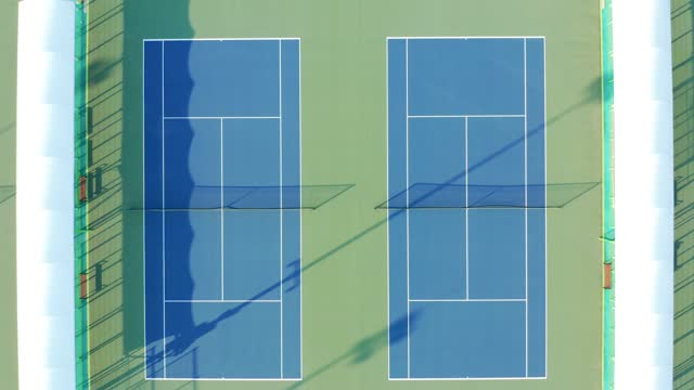 aerial view of empty tennis courts - tennis stock videos & royalty-free footage