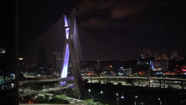 aerial view of estaiada bridge and skyscrapers in marginal pinheiros at night in sao paulo, brazil - cable stayed bridge stock videos & royalty-free footage