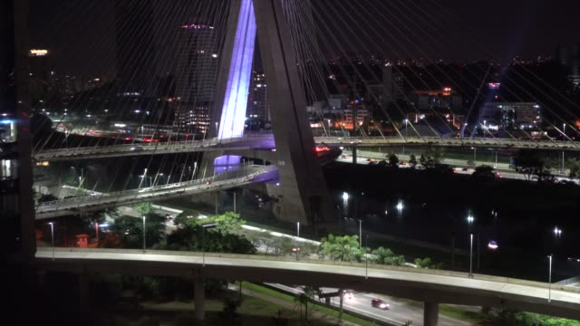 aerial view of estaiada bridge in marginal pinheiros at night in sao paulo, brazil - cable stayed bridge stock videos & royalty-free footage