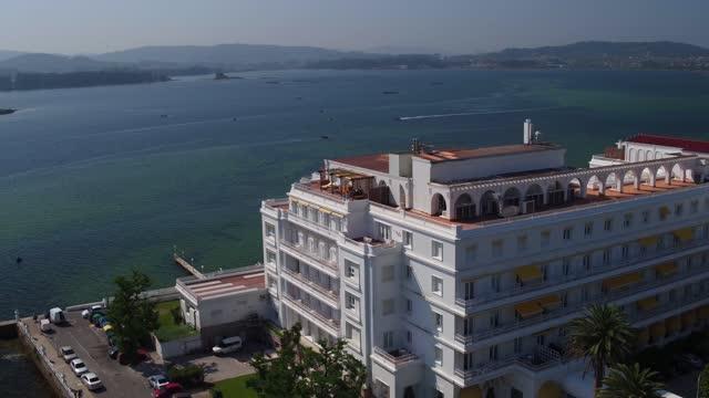 aerial view of eurostarts hotusa hotel in la toja on june, 2017. la toja es una isla española perteneciente a la provincia de pontevedra, en galicia,... - puente stock videos & royalty-free footage