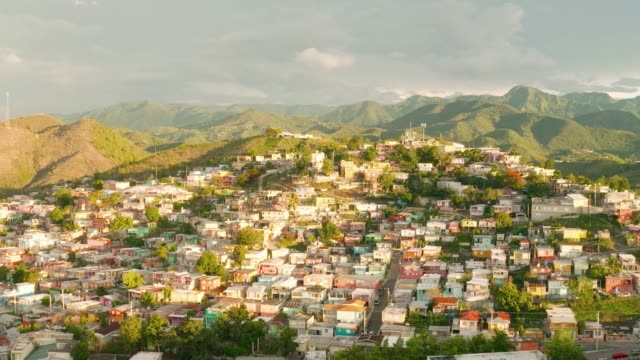 vídeos de stock, filmes e b-roll de aerial view of exotic tropical mountain town 4k - porto riquenho