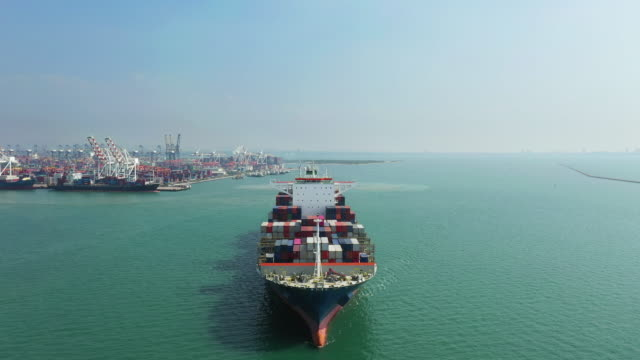 aerial view of export cargo container ship - ship's bow stock videos & royalty-free footage