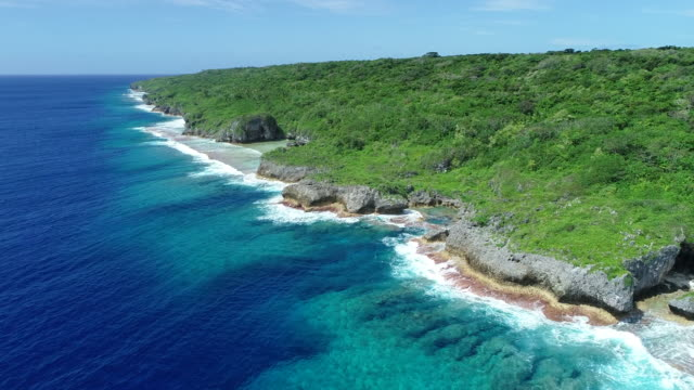 aerial view of exposed coral reef on niue island - samoa stock videos & royalty-free footage