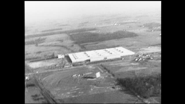 vidéos et rushes de aerial view of factory complex in the middle of plots of land - 1940 1949