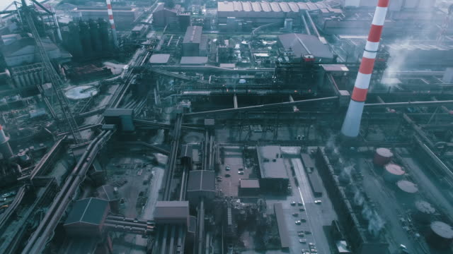 stockvideo's en b-roll-footage met aerial view of factory - bouwmachines