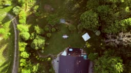 Aerial view of family at garden table for lunch.