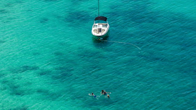 Aerial view of Family enjoyed swimming in the sea