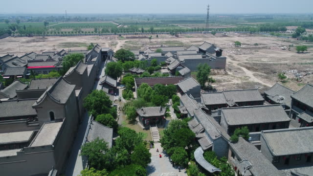 aerial view of famous qiao's grand courtyard in shanxi, china - courtyard stock videos & royalty-free footage