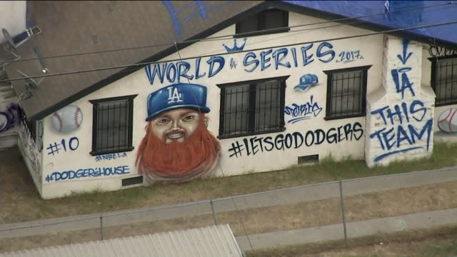 KTLA Aerial View of Fan Celebrating Dodgers World Series by Freestyle Painting Entire South LA Home