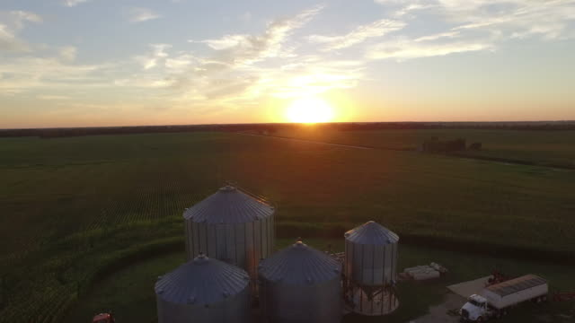 aerial view of farm in rural landscape - deposito video stock e b–roll