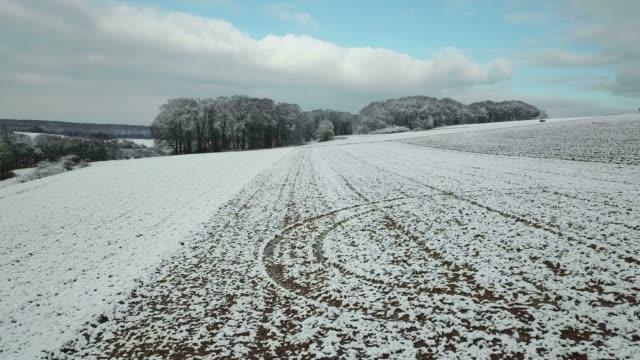 aerial view of farmland in winter near onsdorf, saargau, rhineland-palatinate, germany, europe - rhineland palatinate stock videos & royalty-free footage