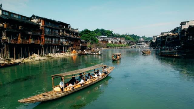 stockvideo's en b-roll-footage met luchtfoto van fenghuang oude stadslandschap, hunan, china - chinese ethnicity