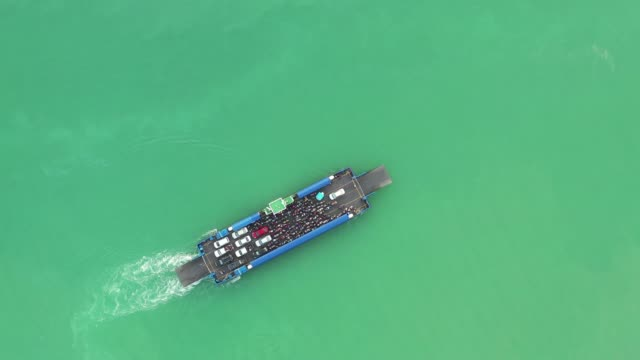 aerial view of ferry boat or ship carry cars and passenger crossing the lake, songkhla, thailand - ferry stock videos & royalty-free footage