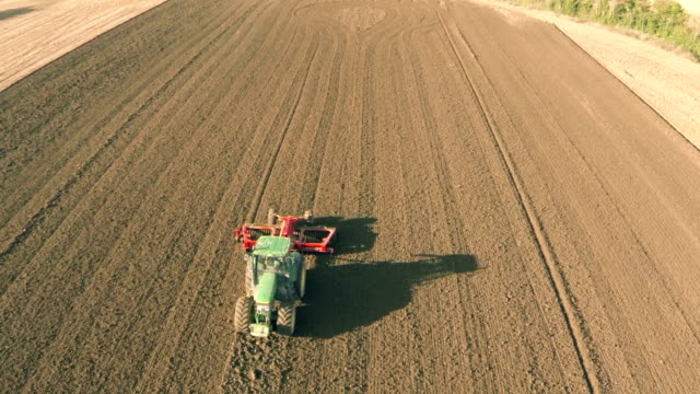 aerial view of field being plowed - agricultural equipment stock videos & royalty-free footage