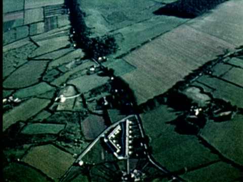 vidéos et rushes de aerial view of field, pilot checking his watch /  audio / germany - 1956