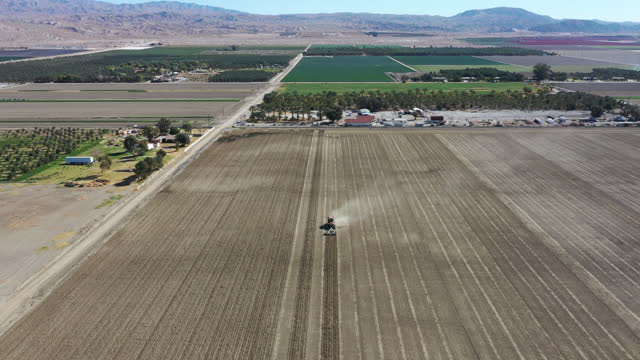 aerial view of fields and farms in coachella, california, u.s., on wednesday, february 17, 2021. farm workers will receive pfizer-biontech vaccine at... - tractor stock videos & royalty-free footage