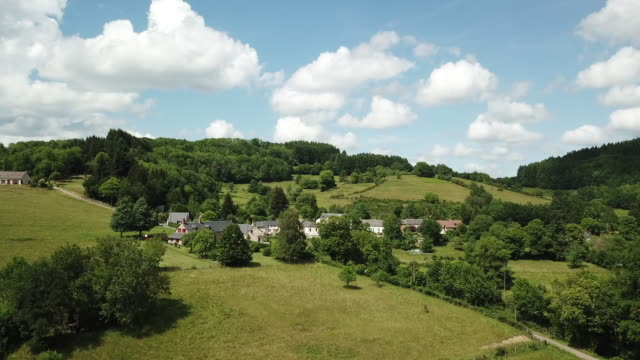 aerial view of fields and forest in the morvan, town - france stock videos & royalty-free footage