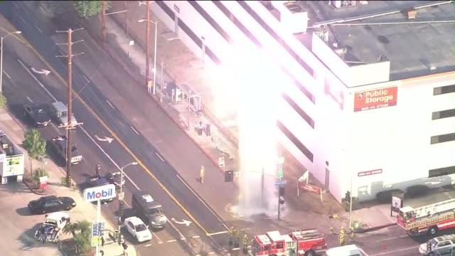 ktla aerial view of firefighters running as flames shoot from doused power pole in hollywood on august 27 2015 the incident began when the fire... - transformer stock videos & royalty-free footage