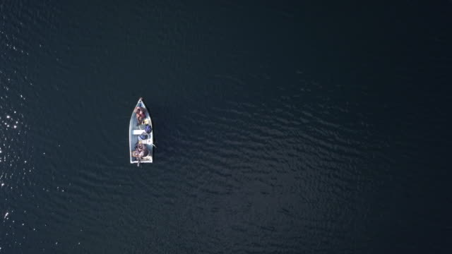 aerial view of fishermans fishing from a boat on lake - active lifestyle stock videos & royalty-free footage
