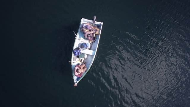 aerial view of fishermans fishing from a boat on lake - fishing stock videos & royalty-free footage