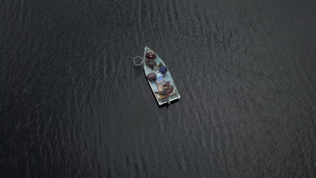 aerial view of fishermans fishing from a boat on lake - fly fishing stock videos and b-roll footage