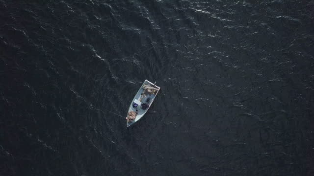 Aerial View of Fishermans Fishing From a Boat