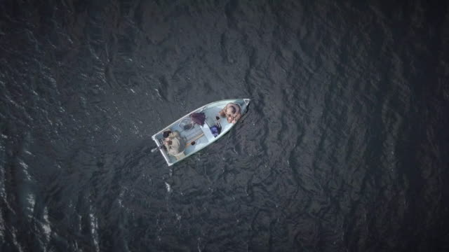 aerial view of fishermans fishing from a boat - televisione a ultra alta definizione video stock e b–roll