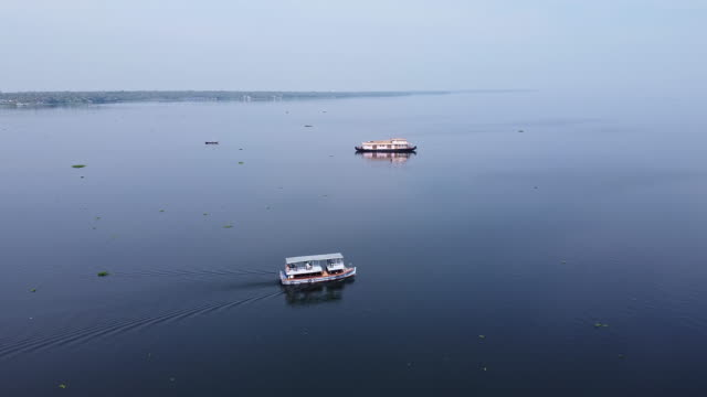 aerial view of fishermen and boats on vembenad lake, kerala / india - canal stock videos & royalty-free footage