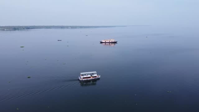 aerial view of fishermen and boats on vembenad lake, kerala / india - backwater stock videos & royalty-free footage