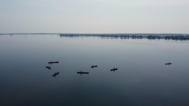 aerial view of fishermen on vembenad lake, kerala / india - backwater stock videos & royalty-free footage