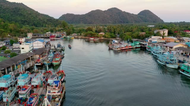 Aerial view of fishing boats standing at the pier in Khanom, Nakhon Si Thammarat province, South of Thailand