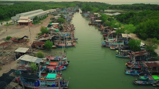 aerial view of fishing boats standing at the pier - thailand stock videos & royalty-free footage