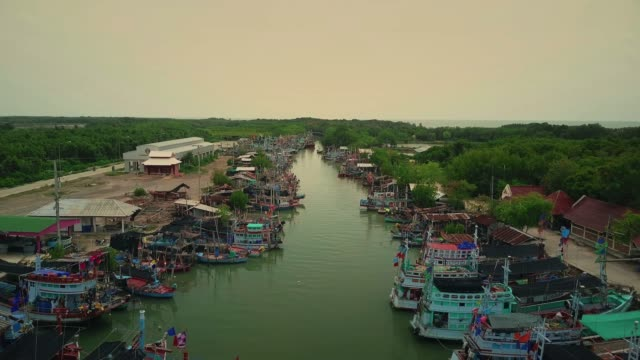 Aerial view of fishing boats standing at the pier