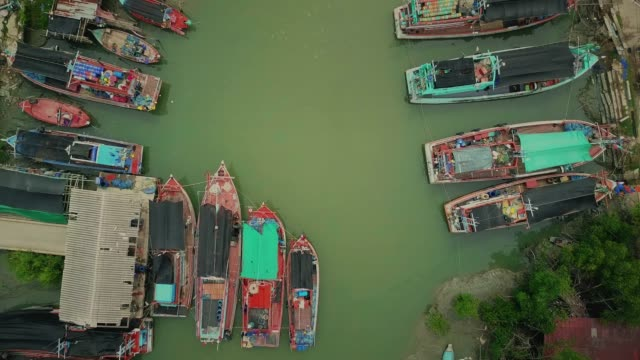 aerial view of fishing boats standing at the pier - fishing industry stock videos & royalty-free footage