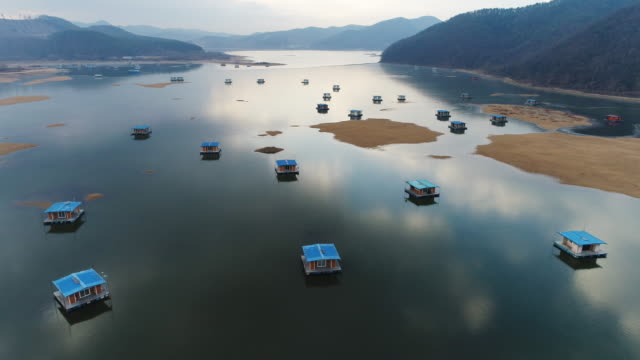 Aerial view of fishing houses in winter at idongjeosuji reservoir