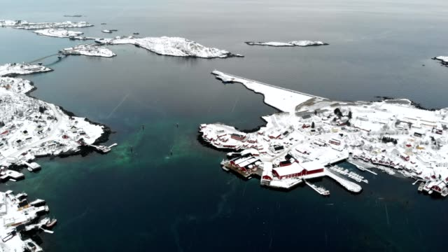 aerial view of fishing village in valley on winter at lofoten islands - fishing village stock videos and b-roll footage