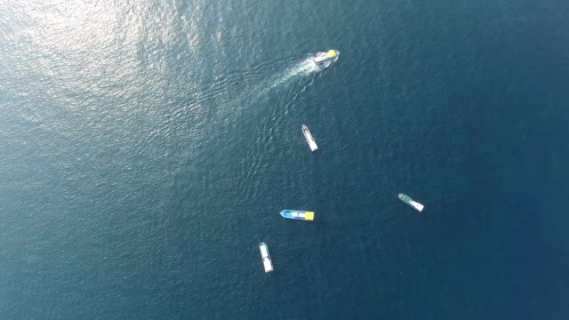 aerial view of five ships in the sea near jeju-do island - 五つ点の映像素材/bロール