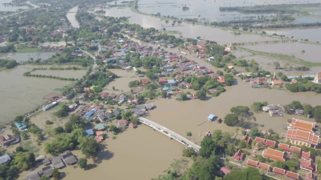 aerial view of flood in ayutthaya province,thailand - torrential rain stock videos and b-roll footage