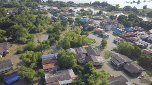 aerial view of flood in ayutthaya province,thailand - flood stock videos & royalty-free footage