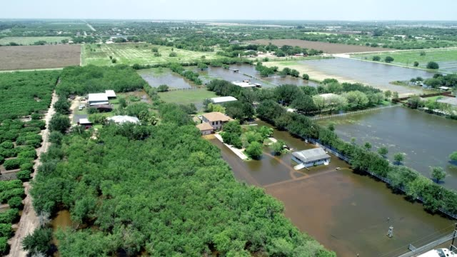 aerial view of flooded countryside as a result from rainfall in mcallen texas - mcallen texas stock videos & royalty-free footage