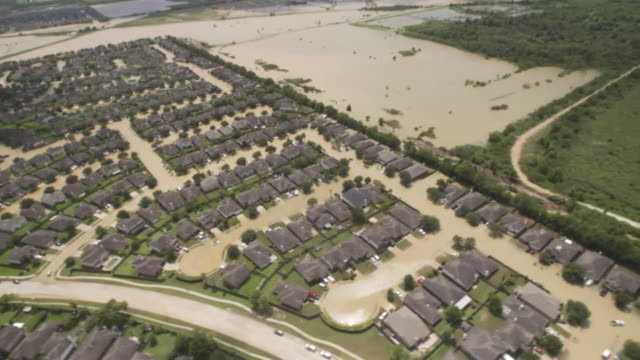 aerial view of flooded streets in houston - hurrikan stock-videos und b-roll-filmmaterial