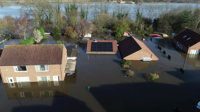 aerial view of floodwater up to roof level on houses in snaith - riverbank stock videos & royalty-free footage