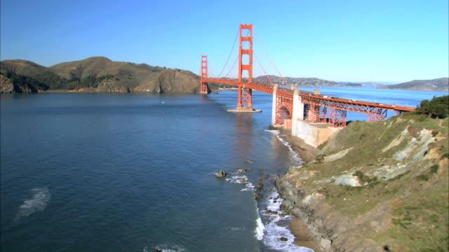 aerial view of flying over golden gate bridge - golden gate bridge stock videos & royalty-free footage