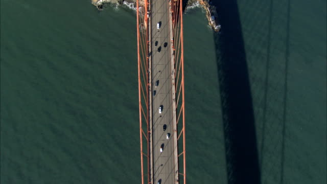 aerial view of flying over golden gate bridge - golden gate bridge stock-videos und b-roll-filmmaterial