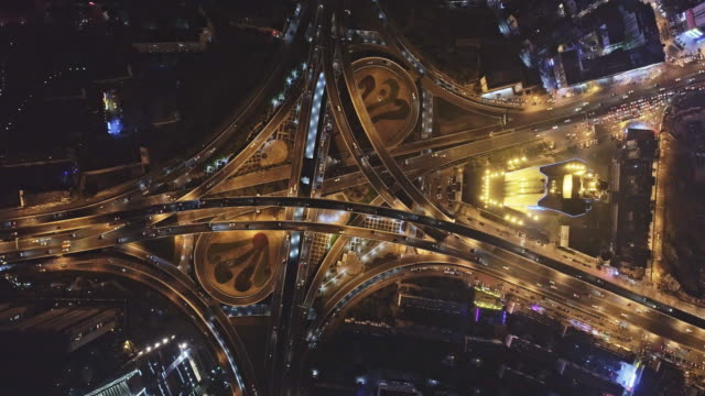 vídeos de stock e filmes b-roll de aerial view of flyover and traffic on april 14, 2017 in hefei, china. - time lapse de trânsito