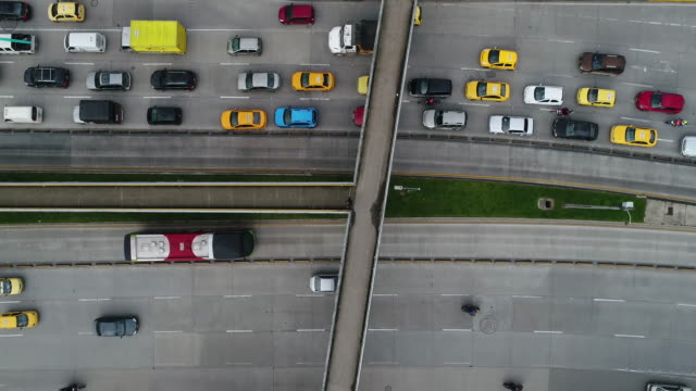 Aerial view of footbridge over traffic moving on highway, Bogota, Colombia